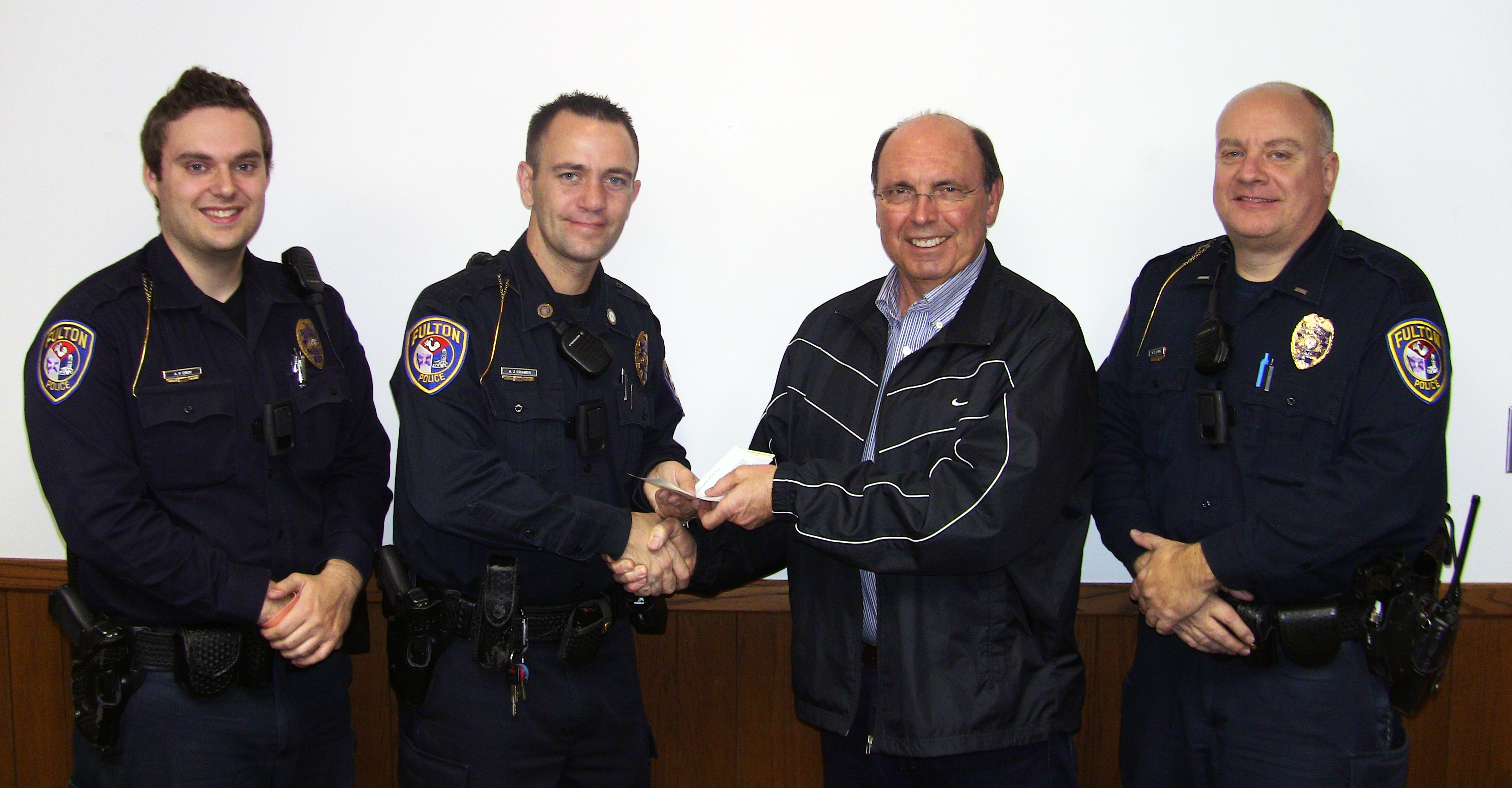 Fulton Police Presents Check To Gurucharri Foundation